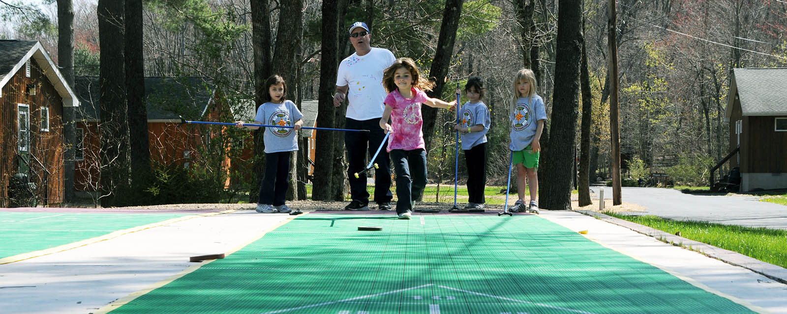 kids playing shuffleboard