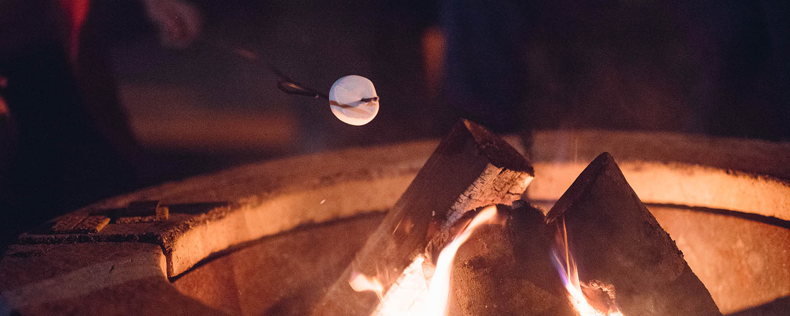 roasting marshmallow over camp fire