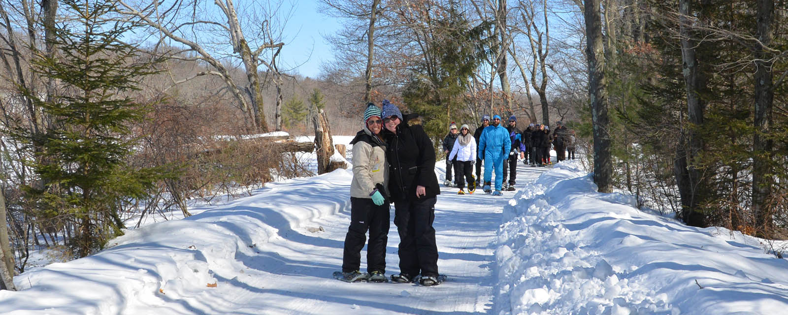 people on winter trail at trout lake retreats